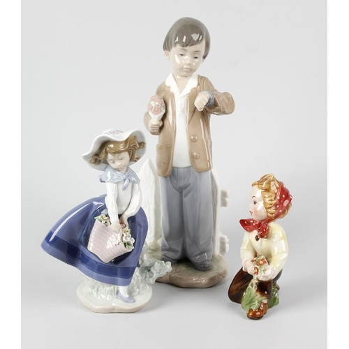 616 - Three boxes containing a selection of glassware and ceramics, to include a Lladro and a Nao figurine...