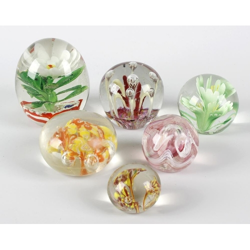 625 - A box containing a mixed selection of assorted glass paperweights, glass dish modelled as a swan, et...
