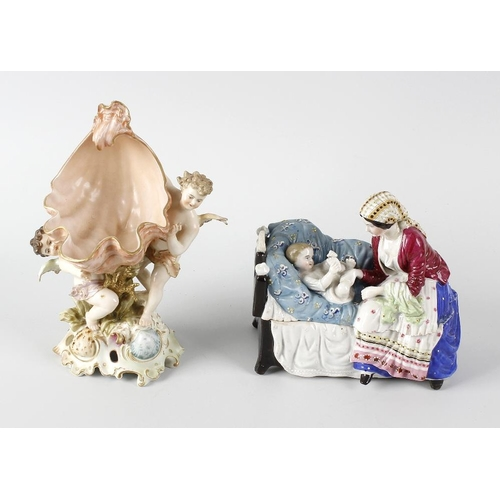 629 - A box containing assorted German porcelain items, to include a Coburg basket modelled with cherub an...
