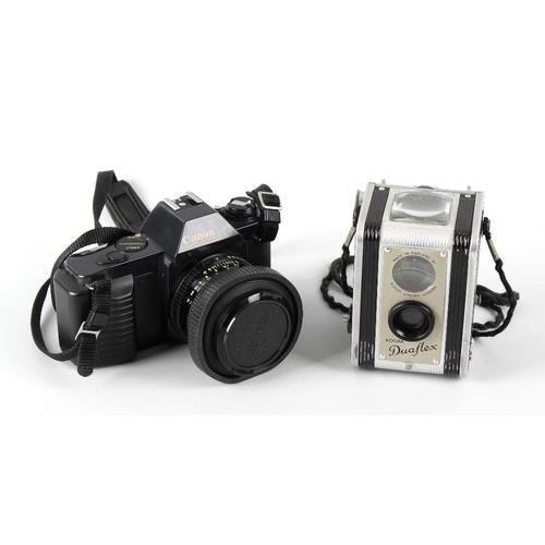 640 - A box containing a Canon T50 35mm camera, Kodak Duaflex camera, Samsung AF slim 200m 35mm camera, et...