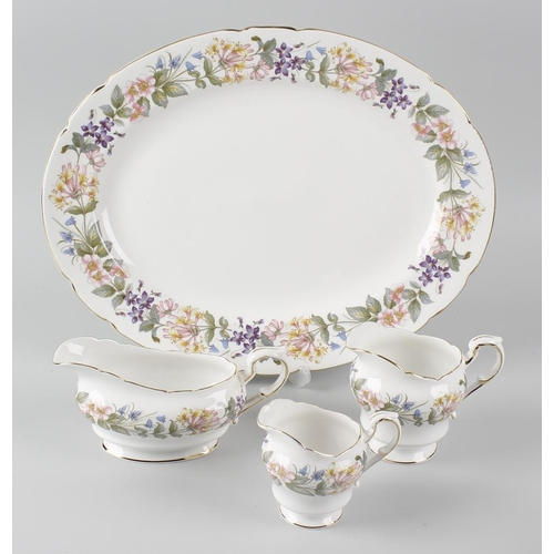 651 - A box containing a Paragon dinner, tea and coffee service in the 'Country Lane' pattern, to include ...