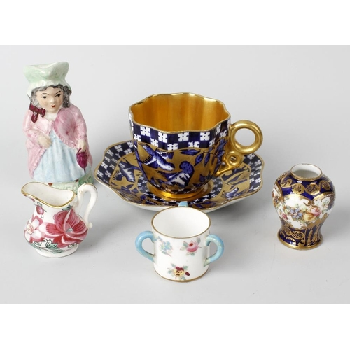 667 - Two boxes containing assorted ceramics, to include a Coalport Aesthetic blue and gilt cup and saucer...