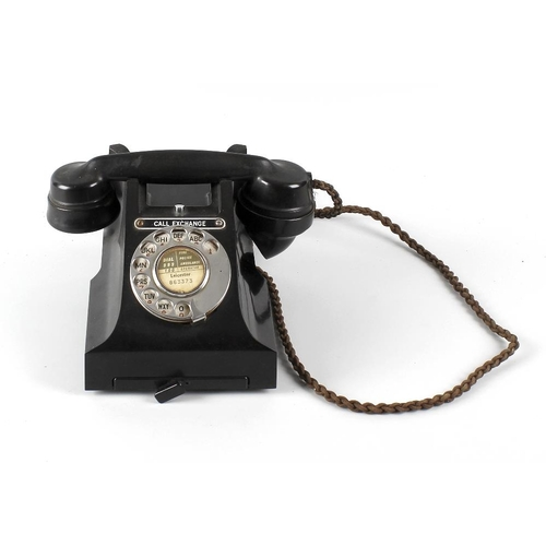 672 - A black Bakelite telephone, a mahogany framed shield shaped wring toilet mirror, and an oak framed t...