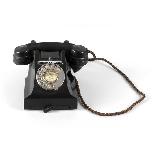672 - A black Bakelite telephone, a mahogany framed shield shaped wring toilet mirror, and an oak framed t...