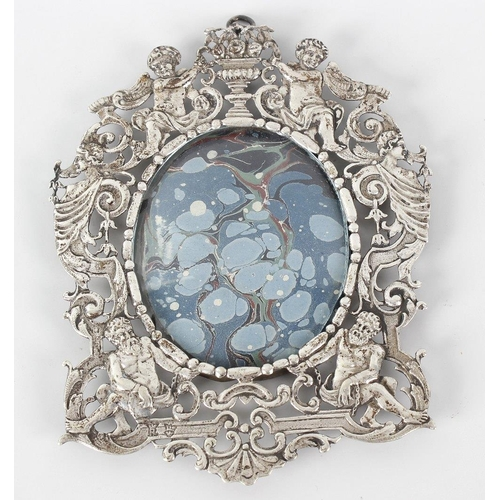 676 - A 19th century wall hanging picture frame with pierced decoration, depicting cupids, caryatids and c...