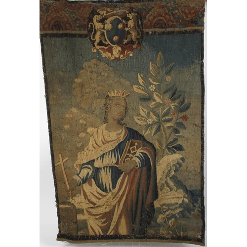 677 - A continental tapestry wall hanging, probably 18th century, depicting a female saint holding book an...
