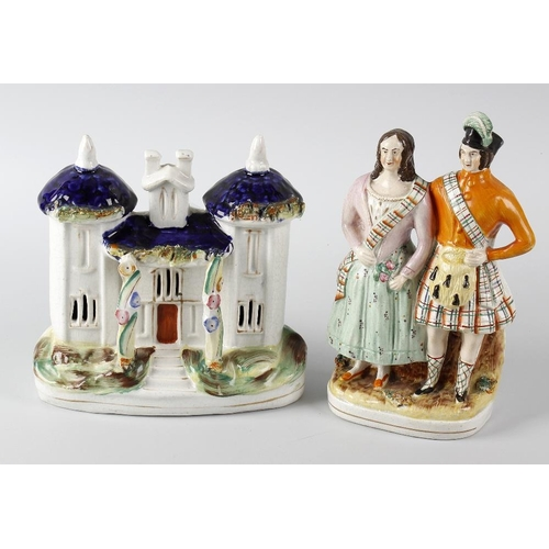 69 - A group of five Staffordshire pottery figures or vases, modelled as a building, highland couple, you...