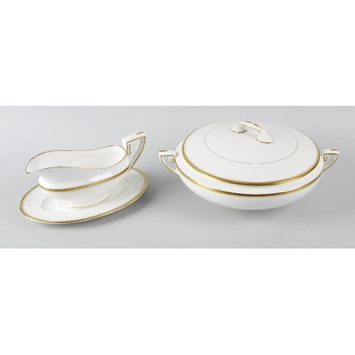 73 - A Royal Worcester dinner service in Viceroy print, comprising three tureen and covers, an oval servi...
