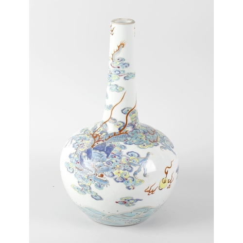 77 - A Chinese bottle vase, of bulbous form with tall slender neck, decorated with a dragon amongst cloud...