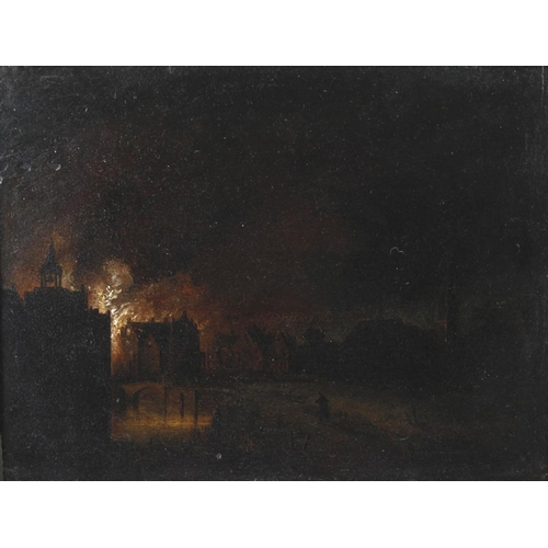 779 - 19th Century Dutch SchoolEvening scene with buildings and bridge burning near a riverOil painting on...