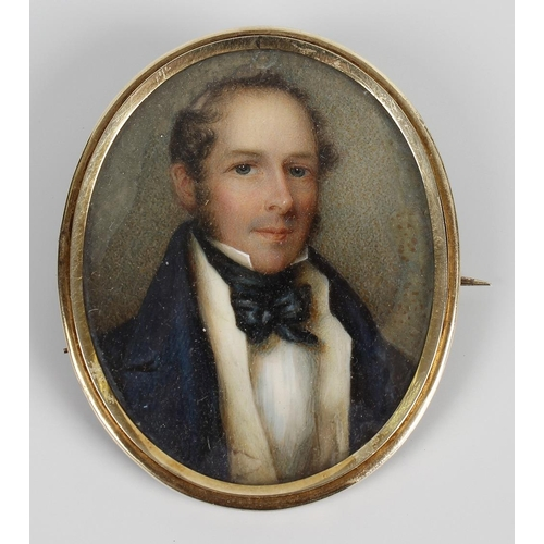 789 - An oval painted portrait miniature on ivory, depicting a head and shoulder study of a gentleman in b...