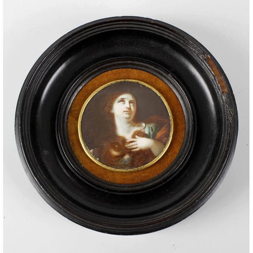 792 - A 19th century circular portrait miniature, head and shoulder study depicting a young female with lo...