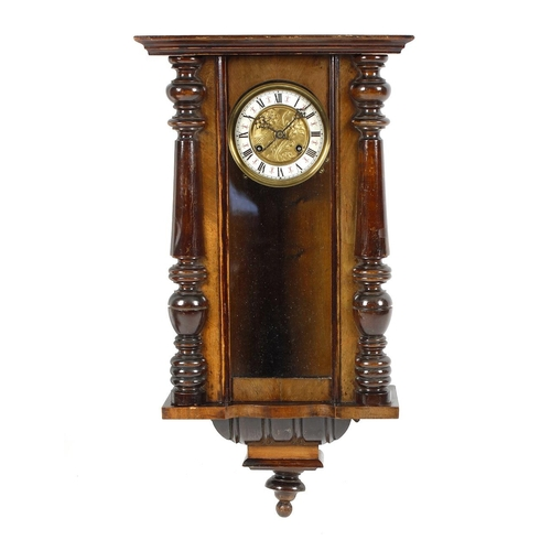 795 - A fruitwood cased Vienna wall clock, circa 1900, with Roman chapter ring framing repousse floral dec...