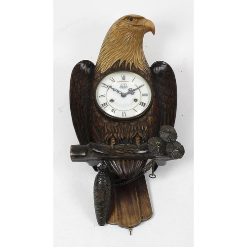 797 - An unusual carved eagle wall clock, the 6-inch Roman dial with eagle motif and banner beneath XII, t...
