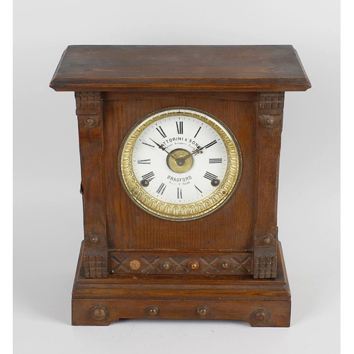 802 - A Fattorini & Sons patent automatic alarm clock in stained wooden case, an early twentieth century s...