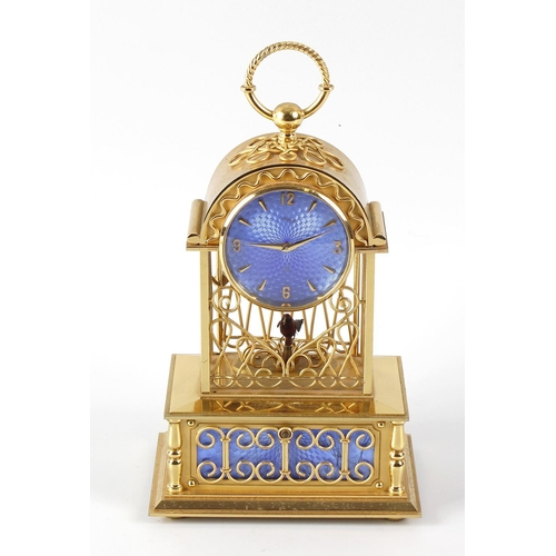 808 - An Imhof mantel clock, the blue enamelled dial with gilt finished numerals and division, the open sc...