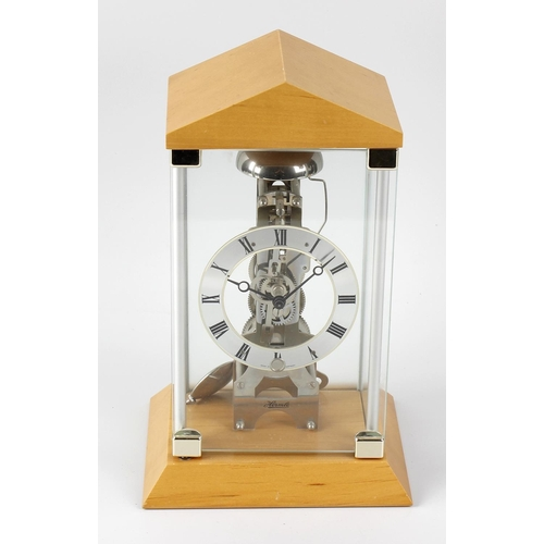 809 - A modern Hermle mantel clock, of A-frame skeleton clock design, the 4-inch silvered chapter ring and...