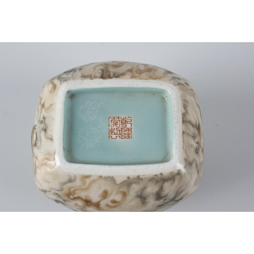 81 - A Chinese porcelain vase or pot, modelled as an open coin purse with low relief moulded draw string,...