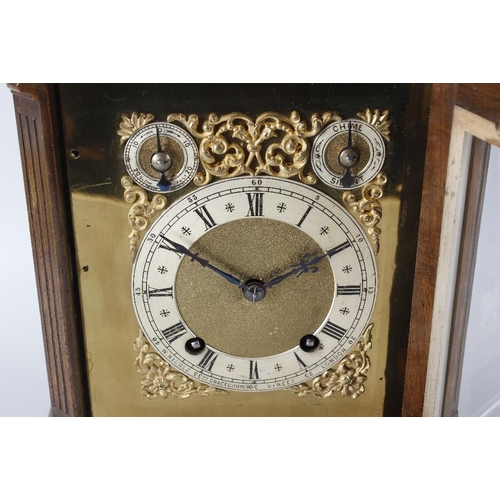 810 - A late 19th century carved and stained walnut bracket style mantle clock, the dial marked 'W Kibble ...