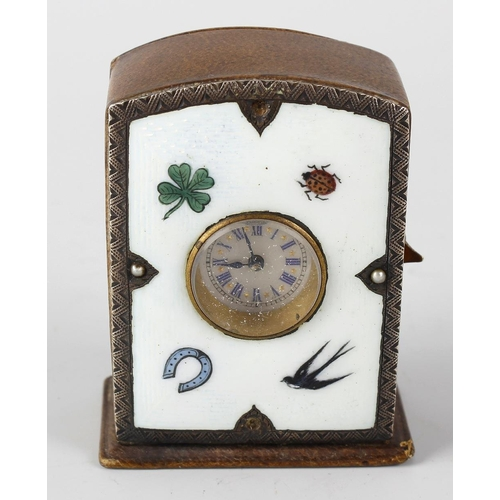 817 - A hide cased desk clock, the enamelled face decorated with four leaf clover, lady bird, horse shoe a...