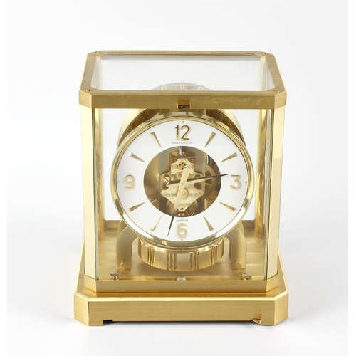 818 - A Jaeger LeCoultre Atmos mantel clock. No. 332199, the 5-inch white chapter ring with Arabic quarter...