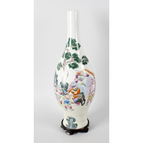 82 - A Chinese porcelain vase, the ovoid shaped body with famille rose decoration detailed with figures, ...