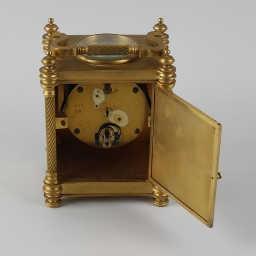 827 - A good late 19th century brass gothic revival combination desk clock. The 3.5-inch silvered Arabic c...