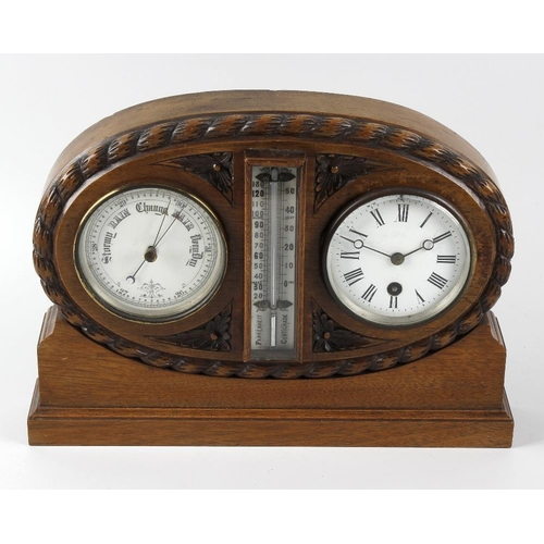 828 - A late Victorian/Edwardian carved walnut combination desk clock. Comprising a single-train timepiece...