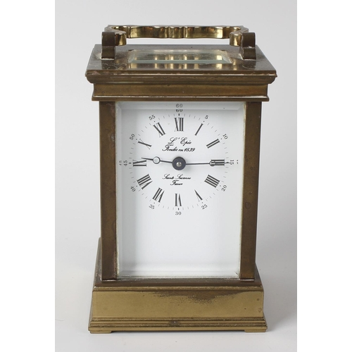 829 - A 20th century French brass carriage clock, L'Epee, Sainte Suzanne. The white-enamelled dial with Ro...