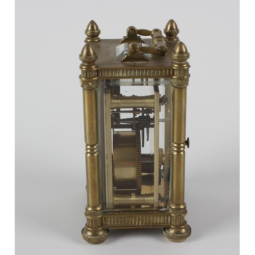 830 - A miniature brass cased carriage clock, the dial having Roman numerals and finely engraved with scro...