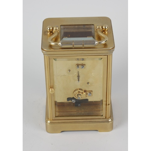 832 - An 'Angelus' brass-cased carriage clock retailed by Asprey, the white-enamelled dial with Roman hour...