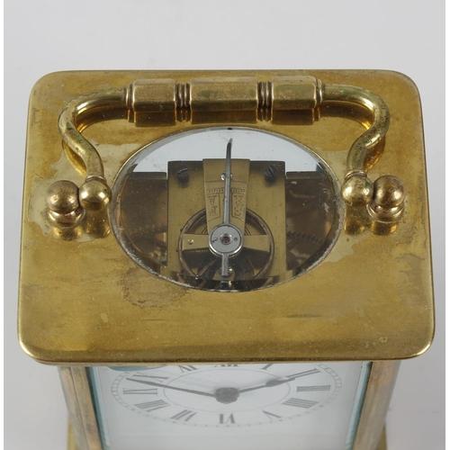 833 - A brass corniche-cased carriage clock. Circa 1900, with white Roman dial, lever platform escapement ...