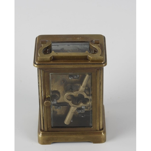 834 - A brass carriage clock with alarm. Circa 1900, with white Roman dial and subsidiary Arabic alarm dia...
