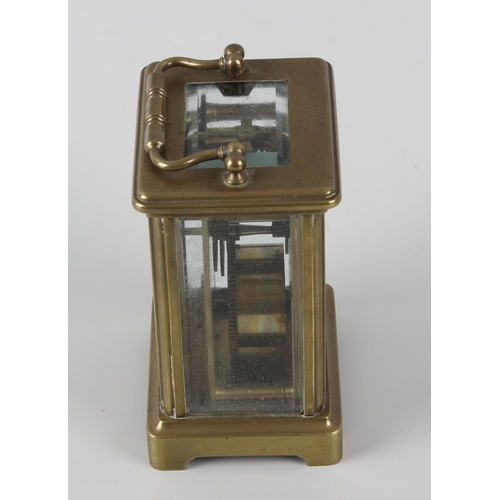 835 - A brass corniche-cased carriage clock. Circa 1900, with white Roman dial, lever platform escapement ...