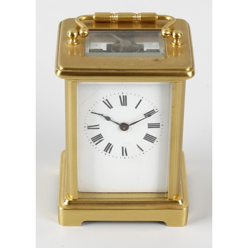 836 - A brass corniche-cased carriage clock. Circa 1900, with white Roman dial, lever platform escapement ...