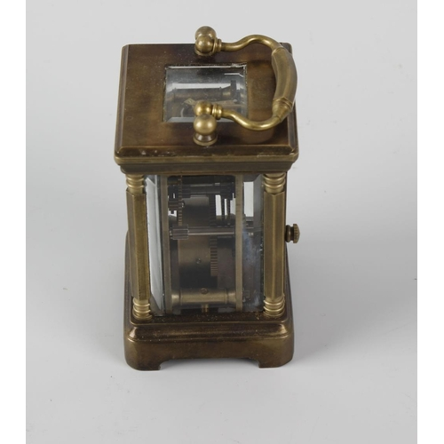 837 - A brass cased 'mignonette' carriage clock. With white Roman dial marked MADE IN FRANCE, with lever p...