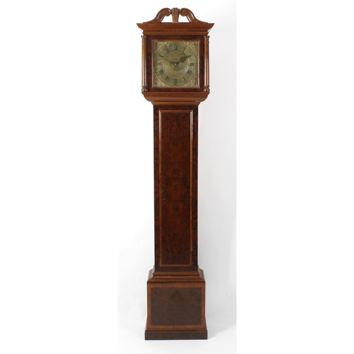 843 - An 18th century and later walnut-cased 30-hour longcase clock. The period 11-inch square brass dial ...