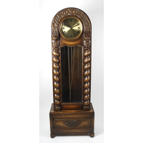 848 - An early 20th century oak cased grandmother clock, the lion and turned column, carved case of arched...