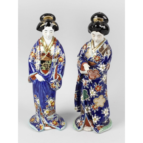 85 - A matched pair of Japanese Ko-Kutani figures, each modelled as a geisha in flowing blue robe with fl...