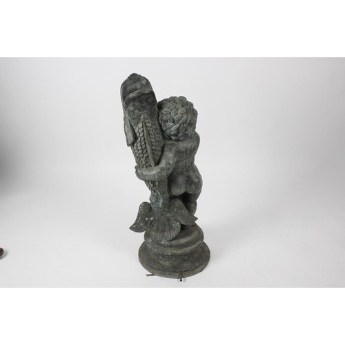 850 - A cast copper figural fountain head. Modelled as a young boy holding a large fish, its open mouth dr...