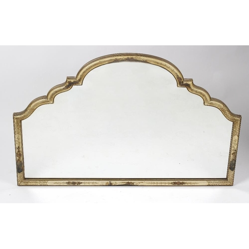 852 - A lacquered wall mirror, of scalloped arched form, the frame decorated with Oriental figures and flo...