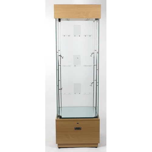 858 - A collection of assorted shop retail display cabinets, to include: an unbranded tall pedestal cabine...