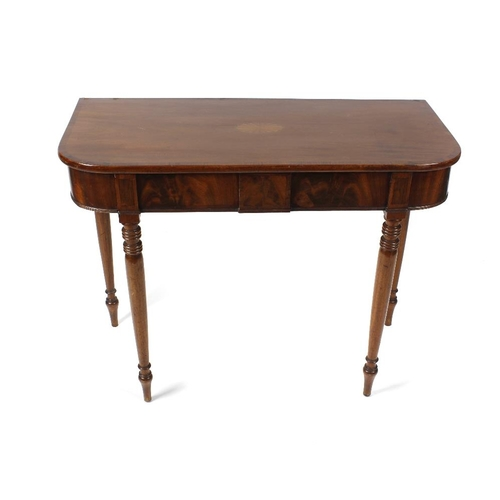 866 - An early 19th century inlaid mahogany side table. The crossbanded top with rounded front corners and...