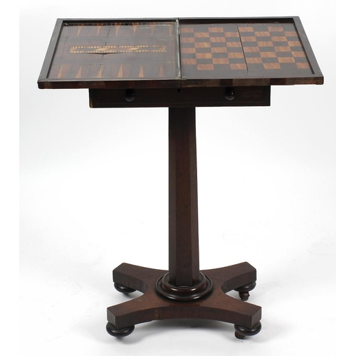 869 - A William IV rosewood pedestal games table, having banded inlay to the hinged rectangular top openin...