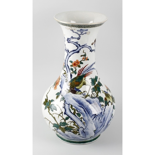 87 - A large Chinese Republican vase, of bulbous form with tall tapering neck and flared rim, the white g...