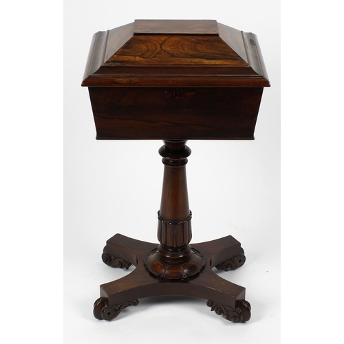 872 - A 19th century rosewood veneered teapoy, the top of sarcophagus shaped form, with hinged opening cov...