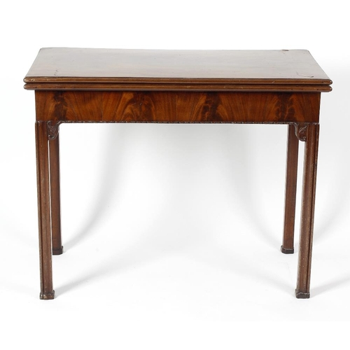 873 - A 19th century Chippendale Revival mahogany fold-over card table. The rectangular top enclosing a gr...