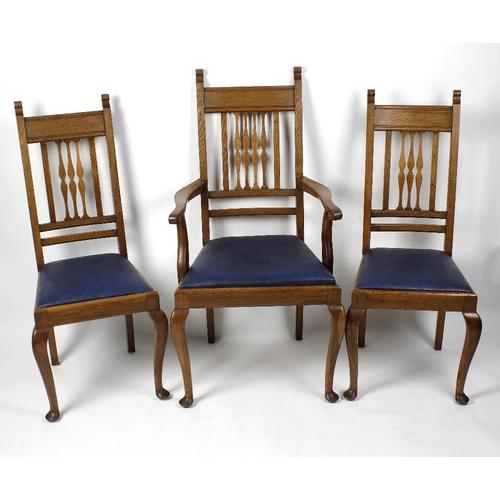 874 - A Lee Longlands (Birmingham) golden oak dining suite. Comprising a draw-leaf table on cabriole legs,...