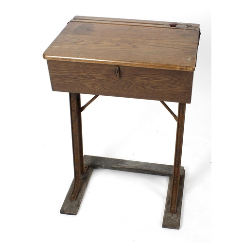 876 - A mid 20th century oak school desk, with lidded brass inkwell, marked 'Kingfisher, West Bromwich', u...