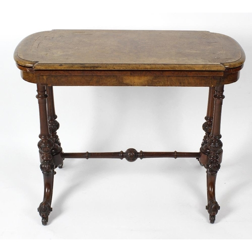 883 - A mid-Victorian burr walnut fold over card table, The top of cartouche form with boxwood stringing, ...